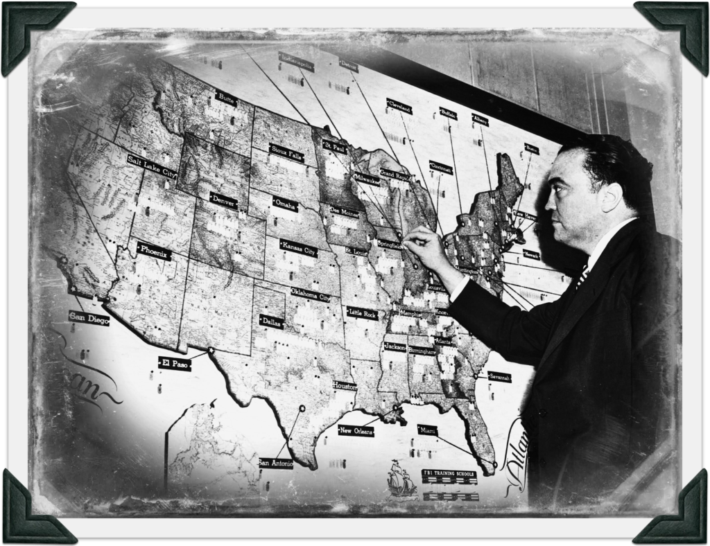 """""""There is no Mafia"""". Hoover standing in-front of US map."""