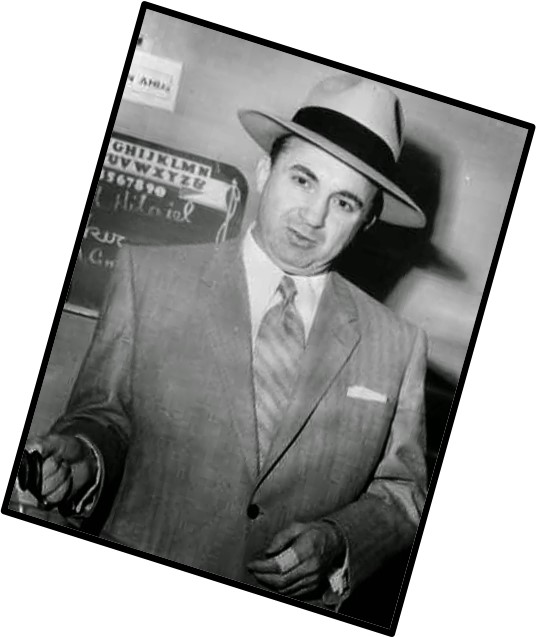 Mickey Cohen, posing for newsmen